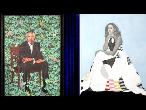 The Obamas each unveil their official portraits