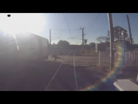 Dramatic CCTV: Commuter narrowly escapes being hit by express train in Australia