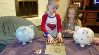 Putting their money from Grandpa in their piggy banks