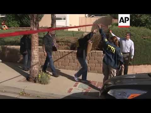 Investigators outside California shooting suspects home