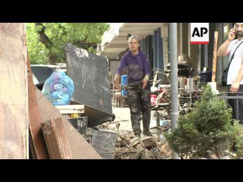Residents struggle to clean up after worst floods ever hit their town