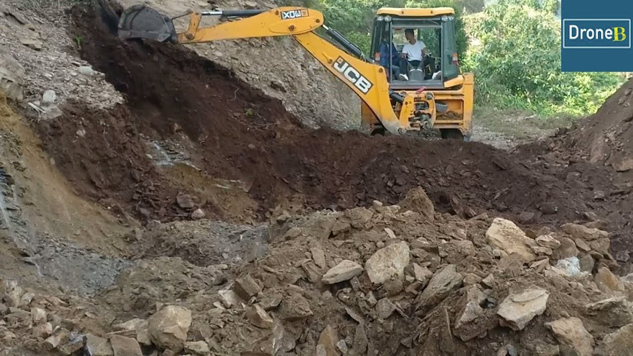Clearing Hilly Blocked Road-JCB Backhoe Loader-Facilitating Hilly Villagers