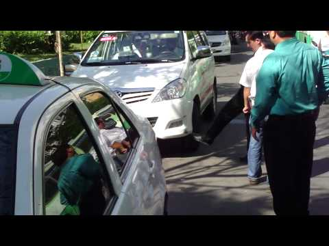 Taxi Cab Traffic Accident in Saigon Vietnam - Guys Shape to Start Boxing Fight.
