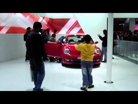 Red Volkswagen Beetle, at Auto Expo 2012, New Delhi, India