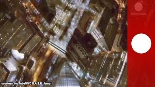 Night base jump in NYC: Skydivers plunge from One World Trade Center