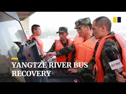 Yangtze River recovery: divers and robot struggle to find sunken bus in China