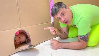 Nastya plays hide and seek with her dad at home