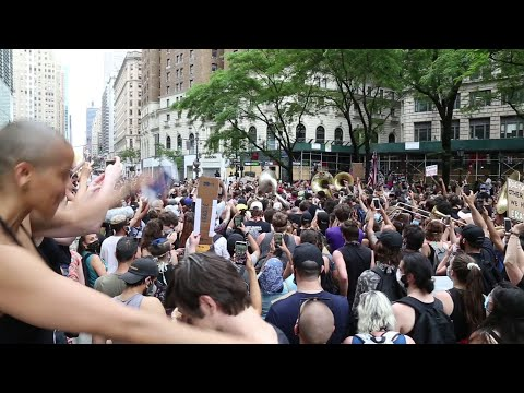 Jon Batiste leads peaceful protest music march