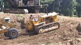 Operating Antique construction equipment. HOW MANY PIECES DO YOU SEE WORKING.   8/13/2011