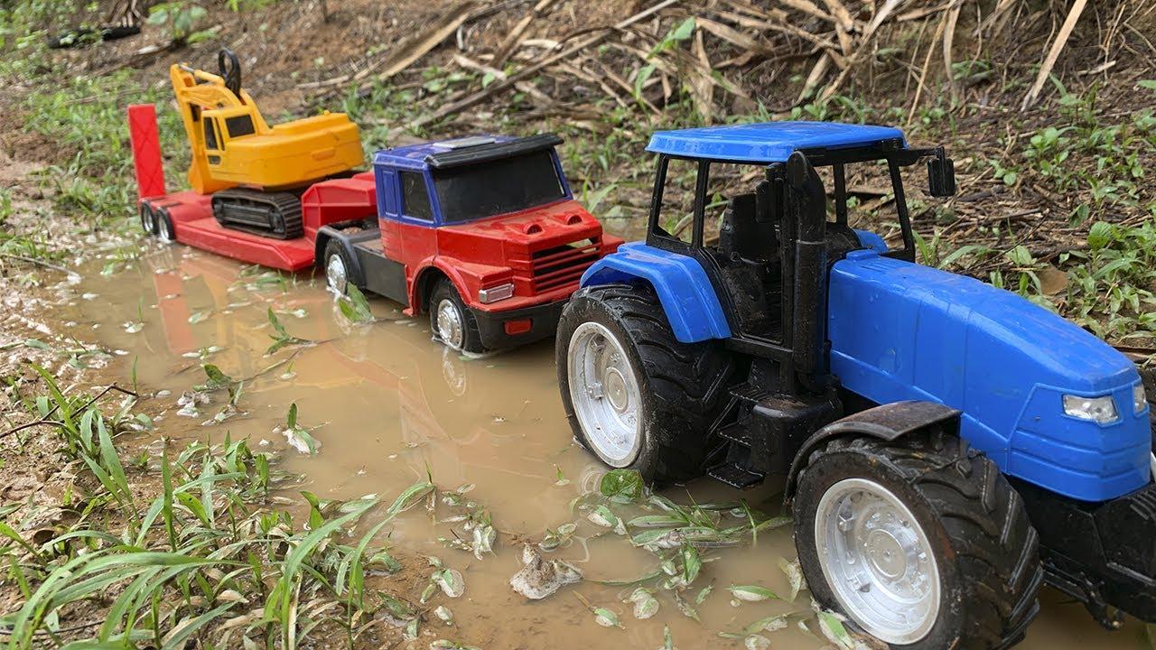 trator tira caminhão do atoleiro, truck in the mud tractor