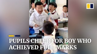 Download Pupils cheer for boy who achieved full marks in China