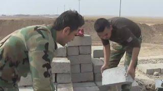 Iraq: Iraqi Kurdish forces build defence barrier north of Mosul