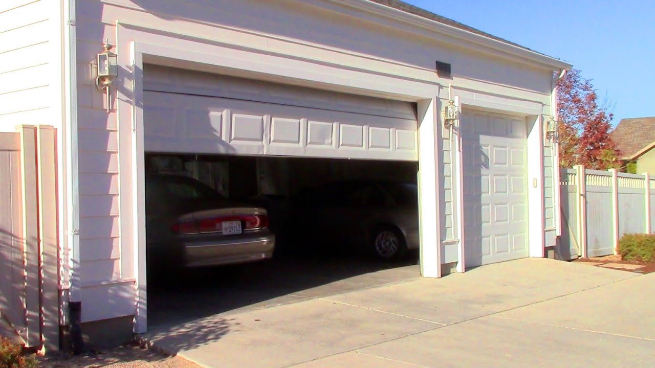 Running car in garage with door open