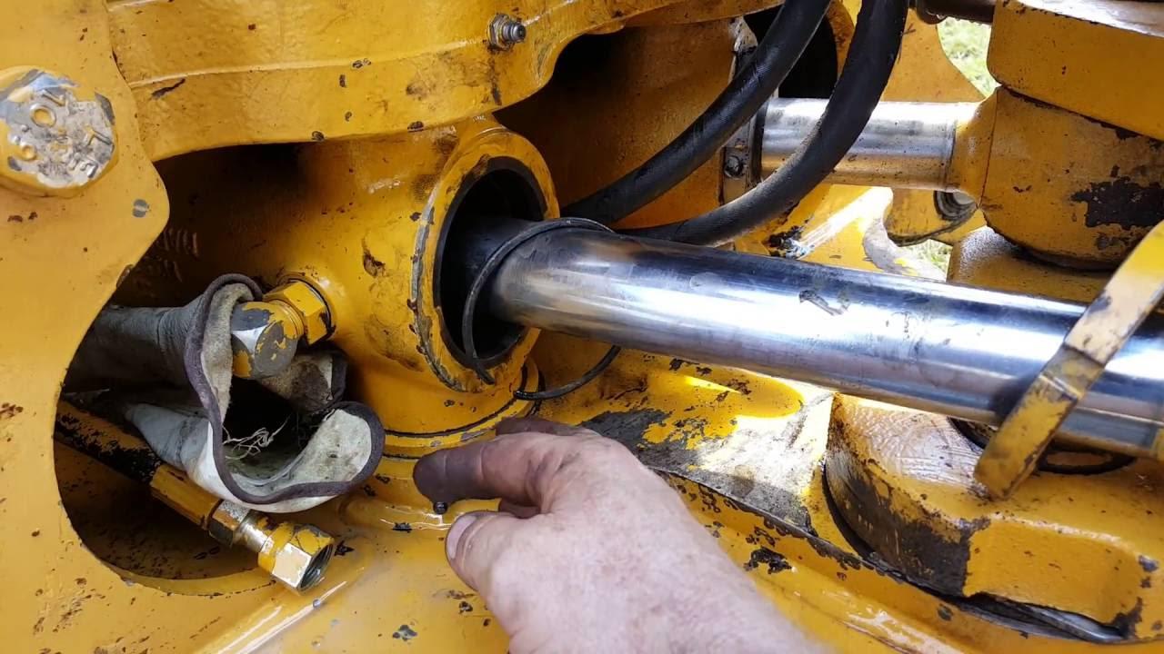 Repair swing cylinder backhoe JD 310 E  YouTube