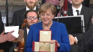 The German Chancellor, Angela Merkel received the 'Lamp of Peace' in Assisi in Italy.
