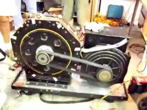 Magnetic motor driving electric generator youtube for Magnetic motor electric generator for sale