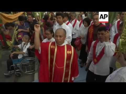 Filipinos at traditional Palm Sunday procession