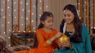 Beautiful mother teaching her cute daughter the concept of money saving - Parenting and Financial