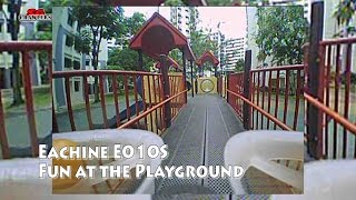 Micro FPV racing drone flying around the playground