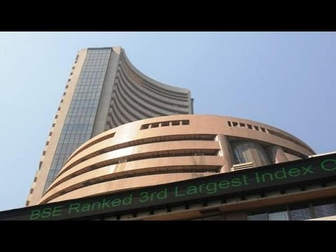 Sensex trading flat, Rupee up 16 paise against dollar