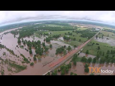 flooding of the red river Disastrous flooding of bossier city and shreveport area  water overflows the westbound lanes of interstate 220 from the red river bridge towards bossier city.