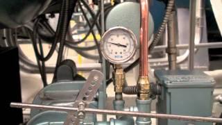 Pressure gauge / metering pump.
