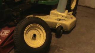 My new lawn Tractor John Deere 190c. Dang wheel fell off.