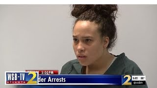 Teen looks stunned as she's charged with murder