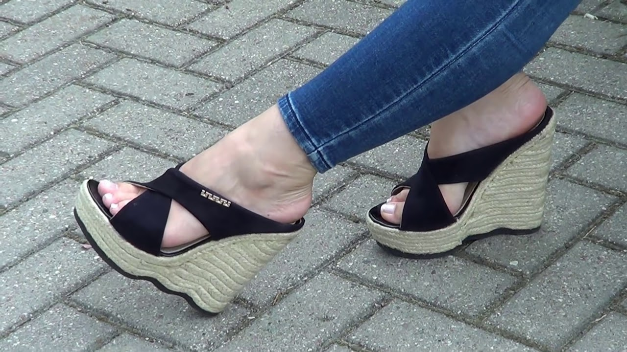 Candid mature wearing wedges