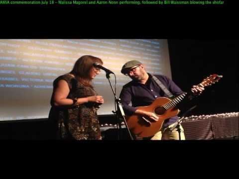 "Malissa Magorel and Aaron Noon performing ""Imagine"" at AMIA commemoration July 18"