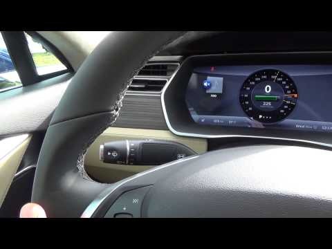 Tesla Motors Model S: Then & Now-Early production and late 2014 production, steering wheel