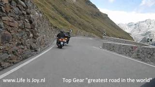 Stelvio / Stilfserjoch pas motorride downhill on BMW R1200GS with snow on the top in august.
