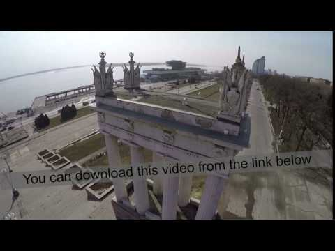 Flying over the aged columns on city waterfront. Volgograd, Russia