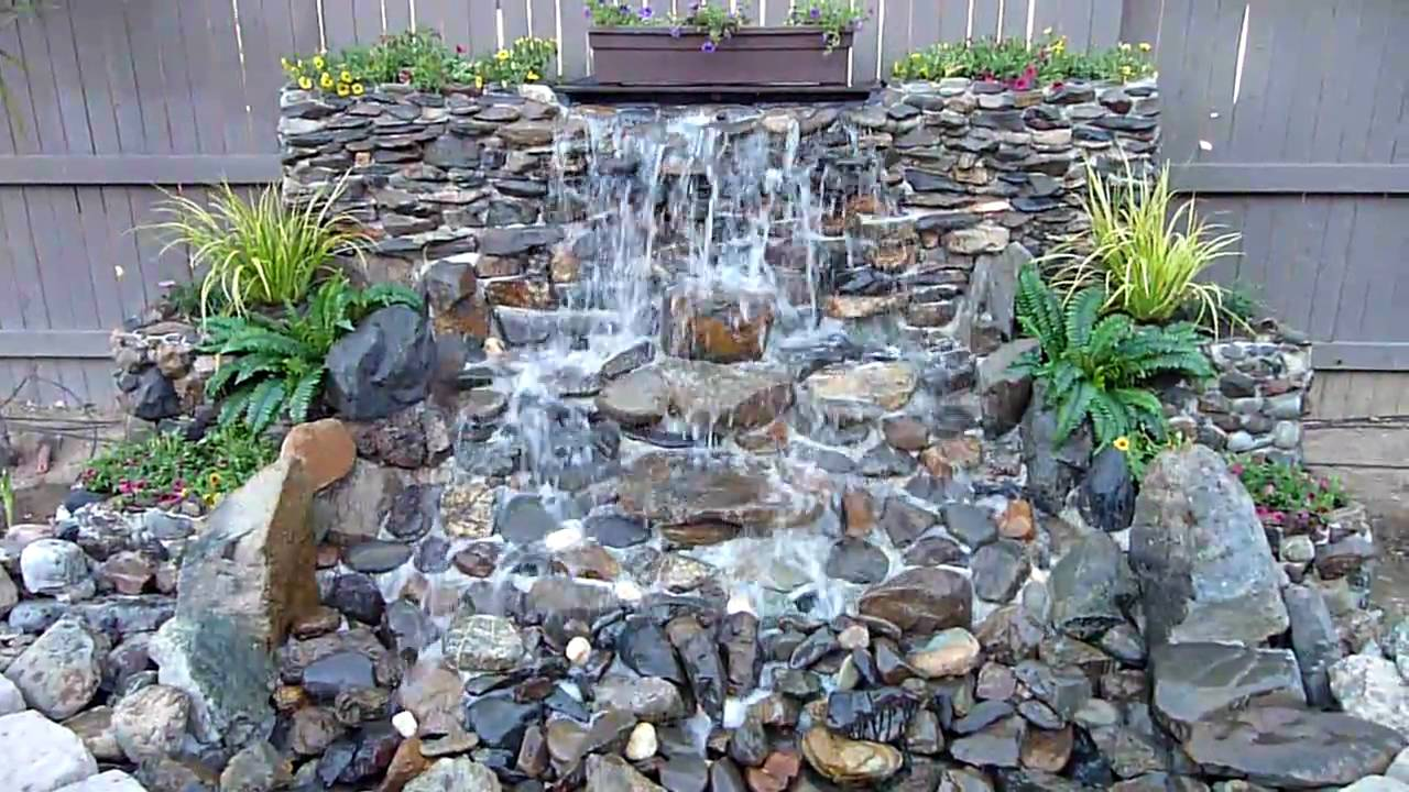 Diy backyard waterfall youtube for Diy small pond with waterfall