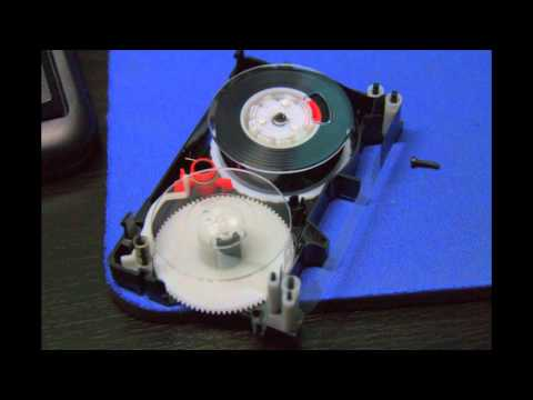 Fixing VHS-C cassette tape - placing parts back