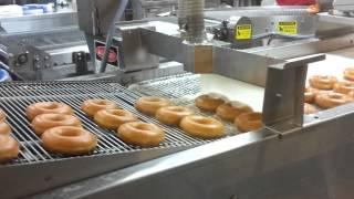 HOT NOW!  Krispy Kreme doughnuts fresh off the line.