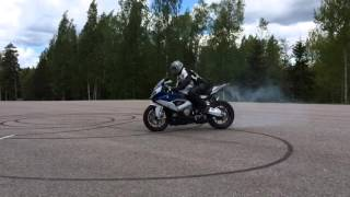 Bomber Magazine test rider do it donuts on BMW S1000RR