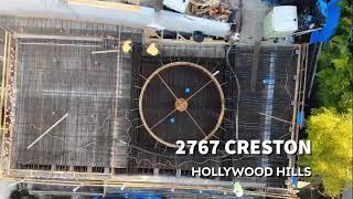 Professional Drone Construction Jobsite Footage In Hollywood Hills overlooking Hollywood