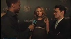 J.LO shows of her huge bump for Madonna's U.N. fundraiser
