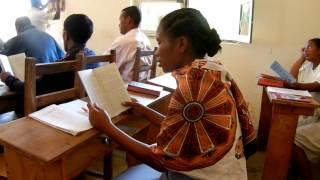 Sunday school teacher reading Augsburg Confession in Malagasy 1