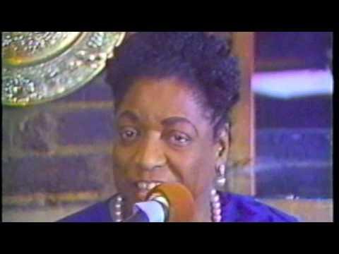 Marie Blake sings