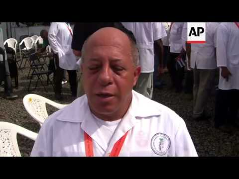 Cuban doctors sent to help fight spread of Ebola attend ceremony at clinic