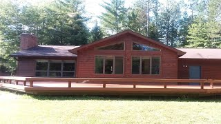 2149 CONTOUR Dr, Roscommon, MI Presented by Tom Bailey.