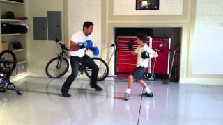 Doing some mitt work with my 10-year-old client