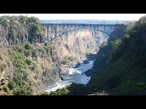 Train crossing Victoria Falls Bridge between Zambia and Zimbabwe