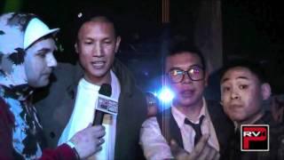 TK Nguyen presents a Magnum Belvedere Vodka Bottle to Poreotics