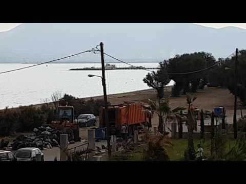July 2017 in Greece with Big Garbage on every corner in Greece. Loading dump with a dredger.