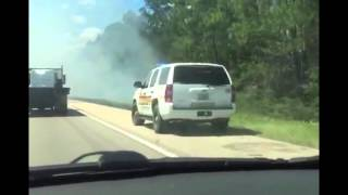 Grass fire on I-10 in Hancock County