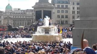 Scottish fans on the fountain in Trafalgar Square