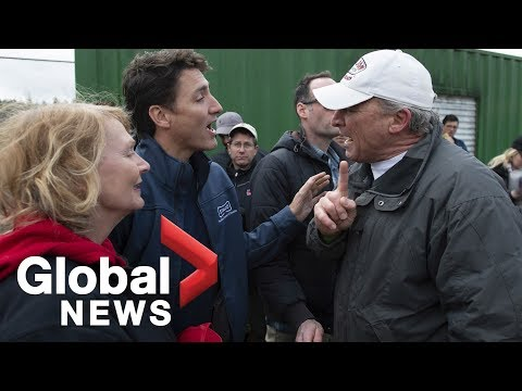 Volunteer berates Trudeau, accusing him of 'delaying' sandbag work